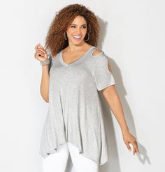 Shop flattering new plus size tops in sizes 14-32 like the Cold Shoulder Sharkbite Top available online at avenue.com. Avenue Store