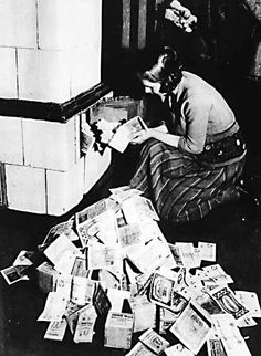 A woman burns German marks in the furnace to heat the home during the peak of the Weimar Germany hyperinflation. Berlin, World History, World War Ii, History Online, Old Pictures, Old Photos, Rare Photos, Vintage Photographs, Vintage Photos