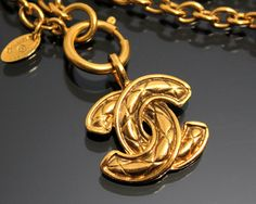 Vintage CHANEL Gold Logo Necklace by fashionsquid
