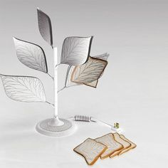 The Toaster Tree has got fancy transparent leaves that hold your bread, till they are done. Transparent nano-electric membrane technology is what the designer cites in support of the crisping/browning element. (Designed by: Xu Yan Xiang) Cool Kitchen Gadgets, Kitchen Hacks, Cool Gadgets, Cool Kitchens, Kitchen Stuff, Future Gadgets, Kitchen Ware, Kitchen Products, Kitchen Tools
