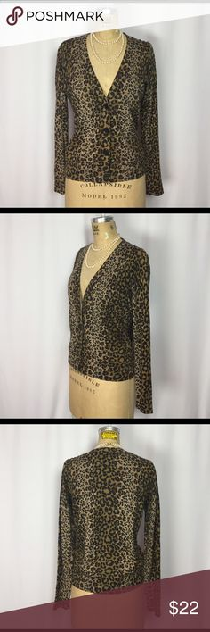 "Talbots V-neck Leopard Print Charming Cardigan. MP Talbots Petites V-neck Animal Print Charming Cardigan.  	•	Excellent preowned condition. 	•	Cotton, Spandex and wool blend material. 	•	V neckline. 	•	Black button closure. 	•	labeled a Medium Petite. Measurements of the cardigan in inches when flat: 	•	Shoulders: 17"" 	•	Bust: 18.5"" 	•	Waist: 17.5: 	•	Hips: 17"" 	•	Sleeves: 23"" 	•	Length: 22"" Feel free to contact me with any questions you may have about this sweater. Please take a look at my…"