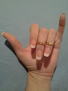 Regular pretty french with pinkish nail, white squared tip, and pretty lil finger tip rings,,, you're welcome =), rings on middle finger are two 14k rose gold rings, 1 with .24cttw bezel set diamonds, the other just a wave band by Gabriel $ 249 total, ring on ring finger open heart band, yellow metal 25 cents fm quarter machine @ family dollar