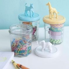 Organize your office supplies on your desk with these painted DIY jars topped with animal figurines.  /getting organized at home