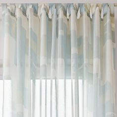 Glaze luxury voile curtain provides the perfect visual accent for your window, whatever the weather outside! Geometric shapes combine to create a multi-facested mosaic of transparency and light, in soft cream and sea green. The watercolours soften the hard, straight edges of the pattern.