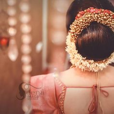 What a beautiful large low bun with gajra! Care however should be taken before adopting such hairstyles, as due to its h Low Bun Wedding Hair, Bridal Hair Buns, Bridal Hairdo, Hairdo Wedding, Wedding Bride, Wedding Dress, Engagement Hairstyles, Wedding Bun Hairstyles, My Hairstyle
