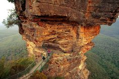 The walk to, and on, this walkway is not for the faint of heart ... The Three Sisters rock formation in the Blue Mountains - Katoomba, NSW  ('On the Rocks' by PacoAlcantara, via Flickr).