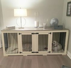 Custom dog crate that serves as a decorative piece as well. Creative!