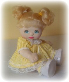 1985 U.S. My Child Doll w/blonde curly pigtails & aqua blue eyes in original yellow floral party dress.