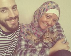 '[A government worker] told me in most cases when people bring their pets from Syria they just kill the animal,' Mr Kadri said, pictured with his wife Nadia and their precious feline