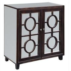 Eye-catching, this light-reflecting mirrored modular cabinet features attractive door overlays. The mirrors are accentuated by the contrasting Afton Espresso Rub-Through frames. The two doors open to reveal a single fixed shelf inside. 30x15x32