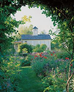 At Martha Stewart's Turkey Hill home, creating a clear footprint and a strong sense of color were the first steps in building her gardens. Martha created entrances to the perennial garden with a pair of rose-covered arches. Garden Show, Dream Garden, Turkey Hill, The Secret Garden, Garden On A Hill, Garden Arbor, Garden Paths, Garden Cottage, New Holland