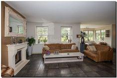Living room witte-barokspiegel-boven-schoorsteenmantel