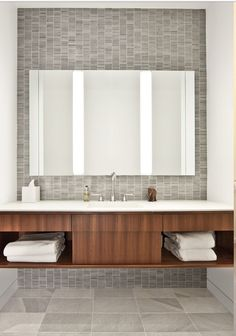 Bathroom. Love the stack bond tile in grey as an alternative to the subway tile. Wood cabinet, no door pulls, white top.