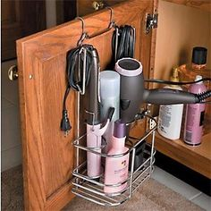 Attach a shower caddy to the inside of a bathroom cupboard to store your blow dryer, flat iron, styling products, etc.