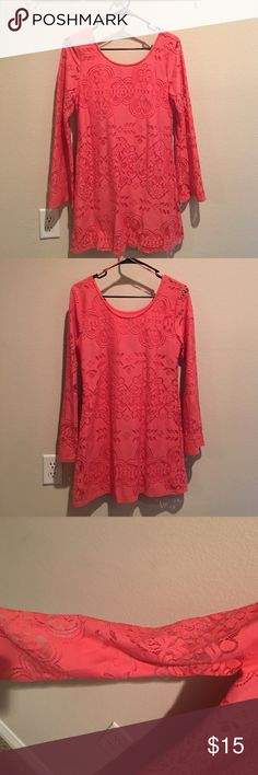 Coral long sleeve dress This coral dress has a lace overlay. The sleeves are full length and flare out at the end. The sleeves are sheer but the dress has a built in coral slip. It falls between mid-thigh and my knees (I'm about 5'3) Only worn once, and still in perfect condition! Perfect for a Valentine's date! (The dark spot in the picture of the tag is the shadow from my phone) Red Camel Dresses Long Sleeve