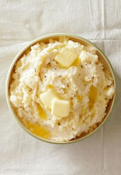 Cook potatoes in your slow cooker with chicken broth, garlic, and a bay leaf for flavor, then blend with whole milk for the quintessential Thanksgiving comfort food. #slowcookersidedish #thanksgivingrecipe #thanksgivingsidedish #potluckthanksgivingrecipe #bhg Holiday Side Dishes, Thanksgiving Side Dishes, Thanksgiving Recipes, Christmas Recipes, Garlic Mashed Potatoes, Mashed Potato Recipes, Cook Potatoes, Traditional Stuffing Recipe, Healthy Holiday Recipes
