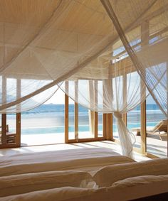 Six Senses Con Dao Vietnam Beachfront Bedroom Eco Elegant Forest Jungle Luxury Mountains Ocean Patio Scenic views Villa Waterfront indoor bed chair property room house Architecture wood interior design home daylighting ceiling Design Resort