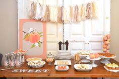 Sweet as a peach baby shower food table