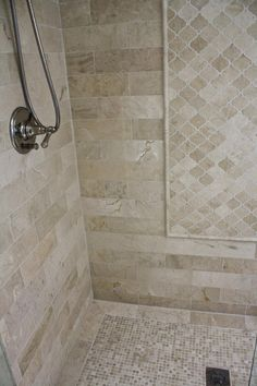different shaped tiles in the same color scheme and material bring dynamic visual interest into this - Ceramic Tile Bathrooms