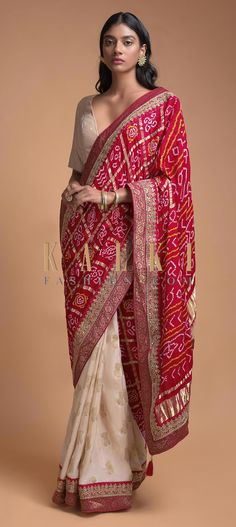 Buy Online from the link below. We ship worldwide (Free Shipping over US$100)  Click Anywhere to Tag Ivory Beige And Red Half And Half Saree In Silk With Bandhani Print And Weaved Floral Buttis Online - Kalki Fashion Ivory beige and red half and half saree in silk with weaved floral buttis on the pleats.Enhanced with weaved red border with gotta patch embroidery.