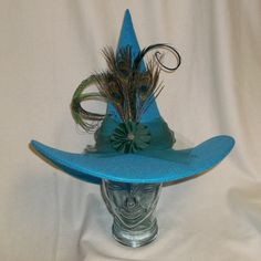 Hey, I found this really awesome Etsy listing at https://www.etsy.com/listing/247647144/fancy-turquoise-peacock-witch-hat