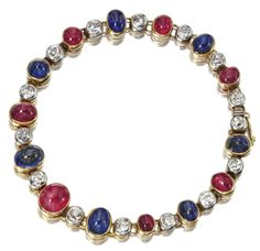 RUBY, SAPPHIRE AND DIAMOND BRACELET, CIRCA 1910.  Alternately set in collets with 7 oval cabochon rubies and 7 oval cabochon sapphires spaced by 15 old-mine diamonds weighing approximately 2.25 carats, mounted in gold and platinum, length 7 inches.