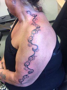 Flowers and swirls, full arm tattoo, tribal swirls, women with tattoos