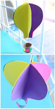 3D Spinning hot air balloon craft for kids using paper and a toilet paper roll! This art project is great for Spring or Summer time | CraftyMorning.com