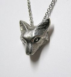 This little fox is clever and makes a gorgeous accessory to any outfit. This wax craving of a fox is casted in solid sterling silver .925. And given
