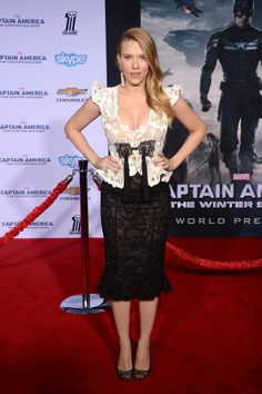 Mom-to-be Scarlett Johansson barely has a bump in a white lace peplum top with tassel detail and a black lace pencil skirt from Armani Privé at the Hollywood premiere of Marvel's Captain America: The Winter Soldier.