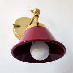 Mid century modern inspired small cone sconce with a maroon purple shade and brass hardware.  Features an adjustable swivel so that the light can pivot next to a bed for bedside reading, as picture lighting, or above kitchen open shelving. Baby Boy Nursery Decor, Nursery Design, Picture Lighting, Bedside Reading Lamps, Sconces Living Room, Purple Interior, Small Space Design, Modern Lighting Design, Sputnik Chandelier