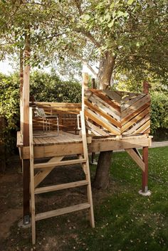 a small deck built around a tree for an intimate grown-up tree house space