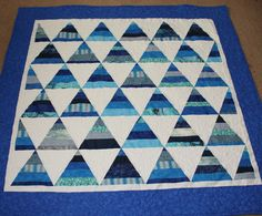 Blue Triangle Quilt, tried something different for quilting the borders pebbles. Critterbug Creations