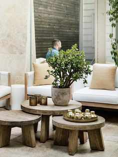 chic garden courtyard with white sofas and wooden tables | photo maree homer