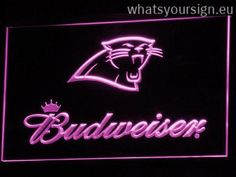 Carolina Panthers Budweiser - LED neon light sign display made of the premium quality clear plastic and intense colorful LED illumination. The neon sign looks exactly the same from all angles thanks to the carving with the latest 3D laser engraving technology. This LED neon sign is a great gift idea! The neon is provided with a metal chain for displaying. Available in 3 sizes in following colours: Green, White, Purple, Blue, Orange, Yellow and Red!