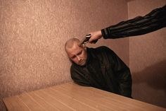 Donald Weber: Inside an interrogation room in Ukraine.  (World Press Photo 2012, Portraits, 1st prize stories)