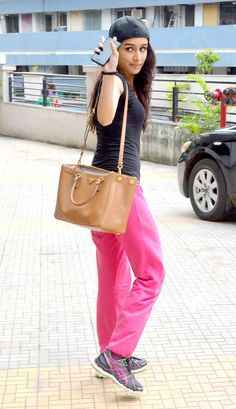 Shraddha Kapoor looked stylish in a pair of hot pink slacks and a black tee while going out of the studio after the practice of her dance routines. #Bollywood #Fashion #Style #Beauty