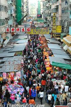 China - Mong Kok is an area in the Yau Tsim Mong District - Ladies' Market is an outdoor street market with lots of stalls where local and tourists can buy anything from copy watches to made in China souvenirs and clothes.