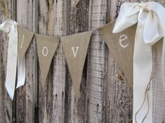 burlap banner with M's name and thick satin ribbon on the sides