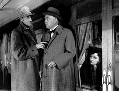 "Basil Rathbone as Sherlock Holmes and Nigel Bruce as Dr. Watson in ""Terror By Night"" (1946)"