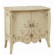@Overstock - This hand painted distressed cream finish accent chest features two functional doors with an adjustable shelf inside for storage. The chest offers elegant antique brass finished hardware.http://www.overstock.com/Home-Garden/Hand-painted-Distressed-Cream-Accent-Chest/6761808/product.html?CID=214117 $519.99