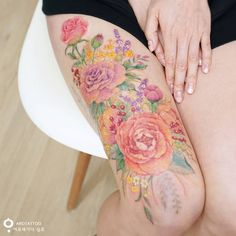 Floral cover-up on thigh.