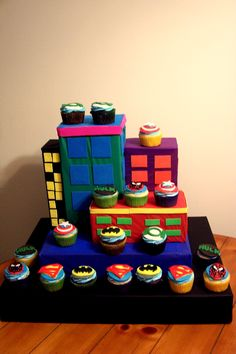 It's a #Super Hero kind of birthday www.CupcakeWhimsy.com check out this custom cupcake tower!! awesome!!
