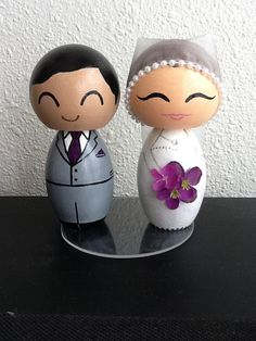 Custom handmade kokeshi cake topper by ohmissco on Etsy. For a couple in Canada. Bride is wearing sheer organza hijab. {www.ohmissco.etsy.com}