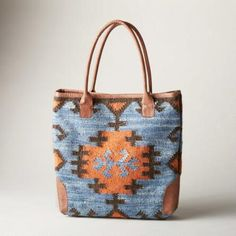The 'Elsa' woven tote bag blends traditional techniques from faraway cultures to create a modern work of art.