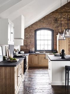 Love the island and the dark wood floor.