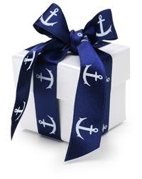 nautical ribbon wrapped boxes as decor