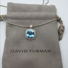 David Yurman Silver 11mm Blue Topaz Diamond Albion Up for your consideration is a beautiful, incredible condition Authentic David Yurman 925 Sterling Silver 11mm Blue Topaz Diamond Albion Enhancer with a Chain Necklace. The pendant measures approximately 16mm wide and comes with a David Yurman Box Chain Necklace measuring approx. 17 inches long. It holds one 11mm Faceted Blue Topaz Stone surrounded by a total of 33 Round Brilliant Cut Diamonds of H-Color, VS-Clarity. David Yurman Jewelry…