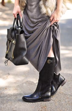 Black leather UGG Riding boots can make you look chic all winter long. Pair your winter look with a black tote, a basic grey maxi and a faux fur vest to top it off.