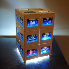 "35mm Slide Box Lamp   by Jennifer Brown  This table light is made using old film slides from a presentation about healthcare. It is really pretty comical to read them and it looks pretty too. The light uses a strand of battery operated LCD's inside a jar to light it up. Measures 6.25"" tall, 4"" wide, 4"" deep. Price: $45.00  On Artful Vision, www.artfulvision.com a portion of your purchase is donated to a participating non-profit of your choice. #art #home #decor #lamp #box #film #slide"